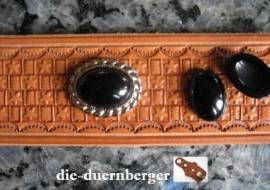 a) Muggelstein schwarz oval Zierniete - Bild vergrößern